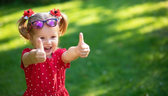 Child In Red Dress In Yard Thumbs Up