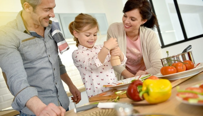 Parents With Child Cooking Together